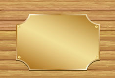 Golden plate. On wooden background Royalty Free Stock Photo