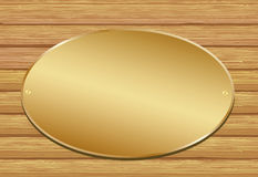 Golden plate. On wooden background Stock Images