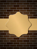 Golden plate on brick wall Royalty Free Stock Images