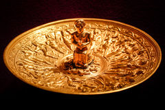 Golden plate ceremonial vessel Royalty Free Stock Image