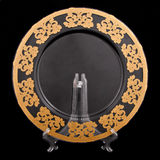 Golden plate. Plate with golden decorate on black background Stock Image