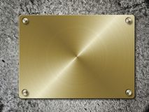 Golden Plate On Concrete Royalty Free Stock Photo