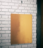 Golden plate side. Side view and close up of empty golden plate on white brick wall background. Mock up, 3D Rendering Royalty Free Stock Photo