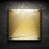 Golden plate on wall. Made in 3d Royalty Free Stock Photography
