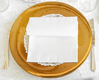 Golden plate in wedding catering Royalty Free Stock Images