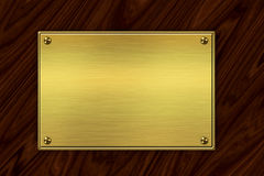 Golden plate on wood Stock Photography