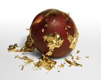 Golden plated peeling peach Royalty Free Stock Photos