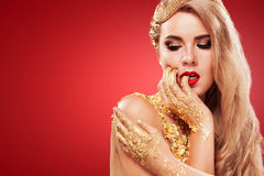 Golden Plated Woman`s Face. Art makeup. Stock Photos