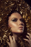 Golden Plated Woman's Face. Stock Image