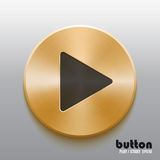Golden play button with black symbol. Round play button with black symbol and brushed golden metal texture isolated on gray background Royalty Free Stock Image