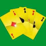 Golden playing cards. On green background Stock Photos