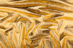 Golden pleats foil background Royalty Free Stock Image