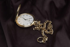 Golden pocket watch Stock Image