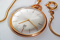 Golden pocket watch Stock Photography