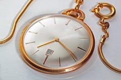 Golden pocket watch Stock Photography