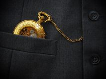 Golden Pocket Watch with Black Mens Waistcoat Stock Photo