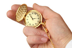 Golden pocket watch in a businessman's hand. Stock Images