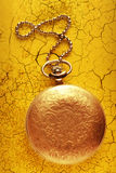 Golden pocket watch with chain Royalty Free Stock Photo