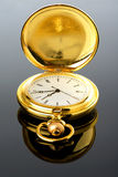 Golden pocket watch on glass with reflection Royalty Free Stock Photos