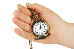 Golden pocket watch in hand Royalty Free Stock Images