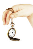 Golden pocket watch in hand Stock Photo