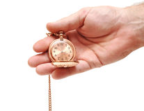 Golden pocket watch in hand on white Royalty Free Stock Image