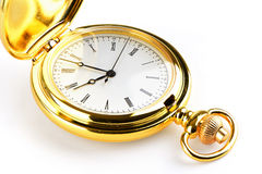 Golden pocket watch isolated on white background. Stock Image