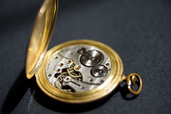 Golden pocket watch mechanism Royalty Free Stock Photo