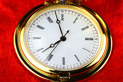 Golden pocket watch on red velvet Stock Images