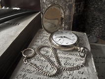 Golden pocket watch - sepia style Stock Images