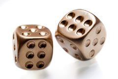 Golden poker dices Stock Photos