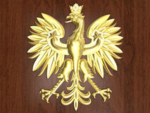 Golden Poland Emblem. 3D rendered illustration of the golden Poland emblem. The emblem is positioned on a wooden background Royalty Free Stock Images