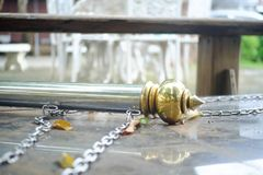 Golden pole stand falling on the marble floor stock photos