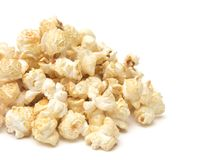Popcorn with Spices Added on a White Background. Golden Popcorn with Spices Added royalty free stock images