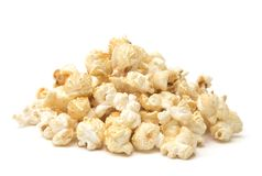 Popcorn with Spices Added on a White Background. Golden Popcorn with Spices Added stock images