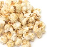 Popcorn with Spices Added on a White Background. Golden Popcorn with Spices Added royalty free stock image