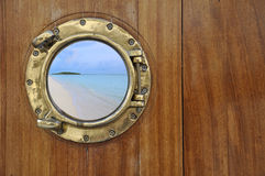 Golden porthole Royalty Free Stock Image