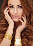 Golden portrait of beautiful woman. Stock Photography