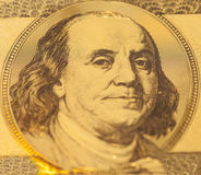 Golden Portrait of Benjamin Franklin on a one hundred dollar ban Royalty Free Stock Image