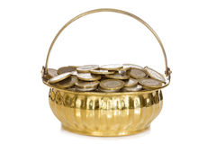 Golden pot full of coins Stock Images