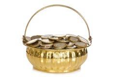 Golden pot full of coins Stock Images