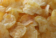 Golden potato chips Royalty Free Stock Images