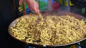 Golden potato dumplings with sauerkraut in a big pan stock video footage