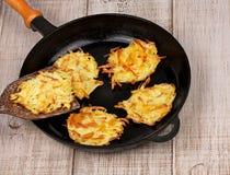 Golden potato fritters stock image