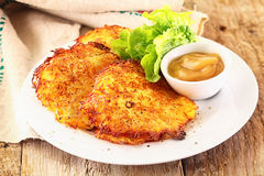 Golden potato fritters Stock Photo