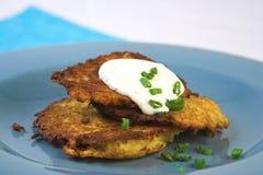 Golden potato pancakes royalty free stock images