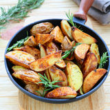 Golden potato wedges with rosemary Royalty Free Stock Image