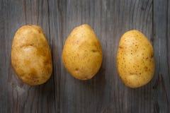 Golden potatoes stock photography