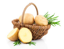 Golden Potatoes in wicker basket  with rosemary Royalty Free Stock Photography