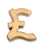 Golden pound symbol Royalty Free Stock Images